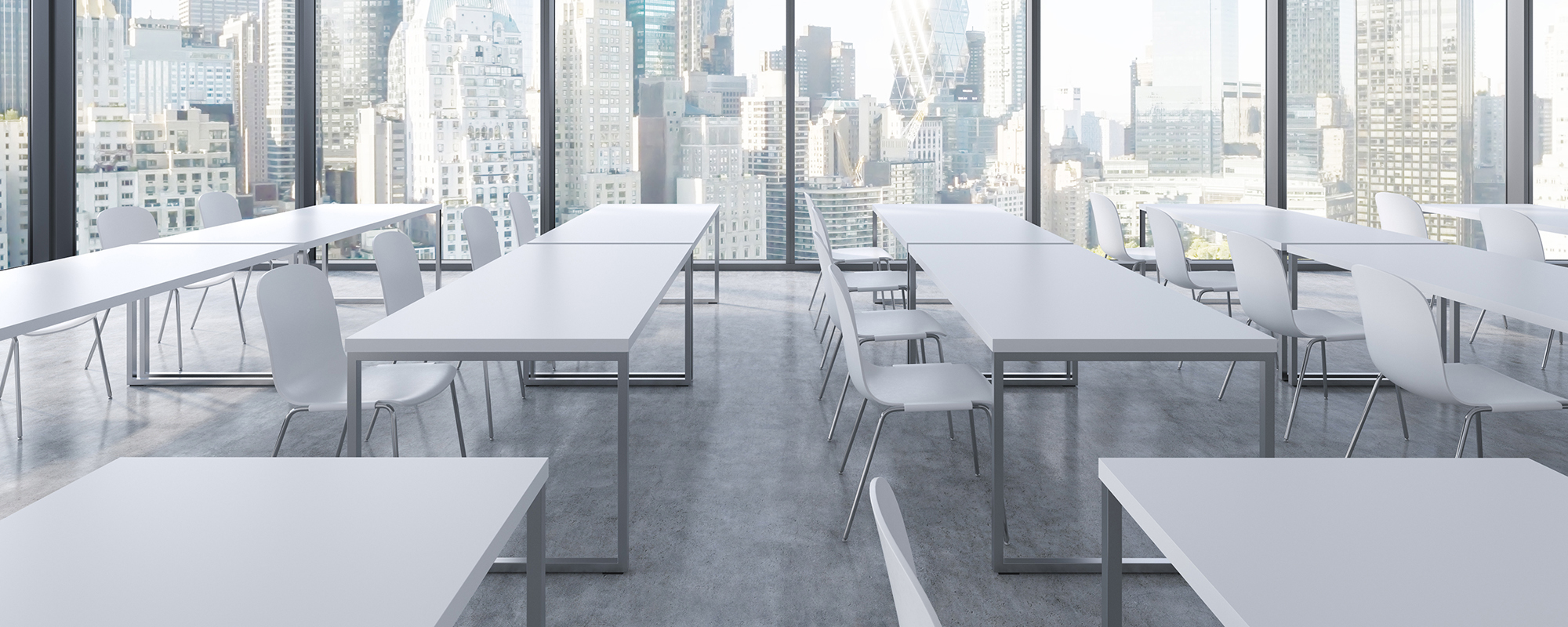 A modern panoramic classroom with New York view. White tables and white chairs. 3D rendering.